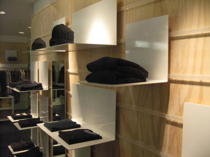 Occupying two floors of a modern structure, the store interior has a the vibe of a plush gentleman's den and features a subtle blend of contemporary style