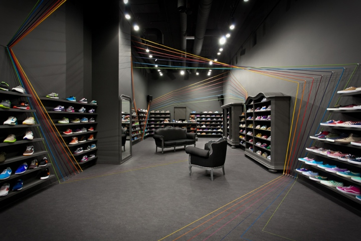 Dark Grey Walls Make A Great Background For A Wide Range Of Shoes In  Different Colours As Well As Coloful Rope Installation. Store Interior Is  Furnished ...