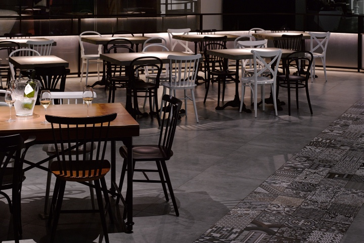 another element used in the coffee shop is the spanish floral tile for the walkway in front of the bar it is different from the typical colorful spanish