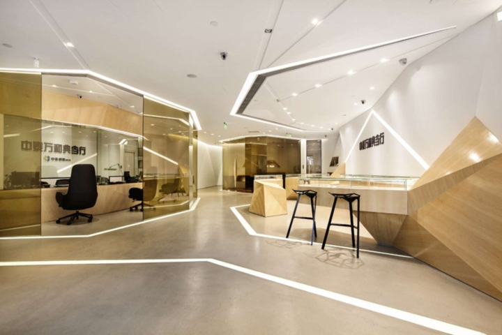 The inviting space s angular wooden display cases sleekly for Retail store interior design