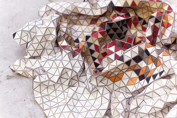 On A Base Fabric, Designer Pasted Rows Of Colored Triangles For Wood, To  Give Birth To A Puzzle Of Textile.