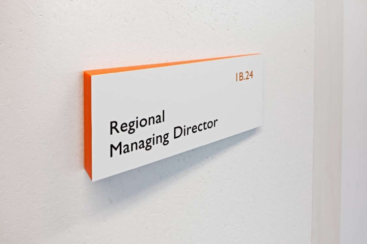 Signage wayfinding tnt green office signage system by for Interior design signs