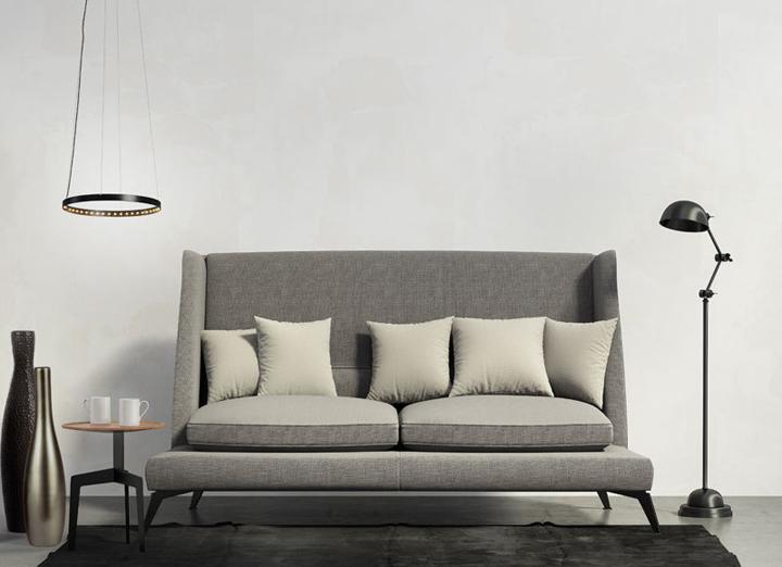 Classic sofa, dark rug, stool and floor lamp, chic living room