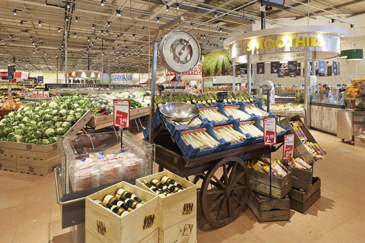 Taking influences from indoor markets around the world  the interior is  punctuated and softened by the introduction of curved architectural  features and. DekaMarkt  World of Food  store by Twelve Studio  Netherlands