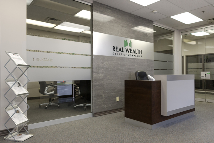 Real wealth corporate office by ambience design group for Small corporate office design