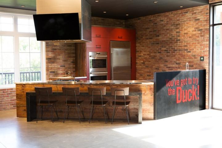 Rustic Modern Aesthetics Permeate An Open Floor Plan With Furniture Polished Concrete Floors Reclaimed Barnwood Blackened Steel
