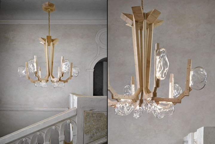Marvelous The chandelier has six arms made from sections of wood that alternate between solid pieces and pairs of slats The batons are arranged so each is angled