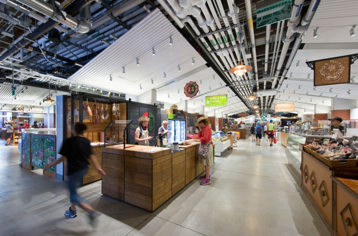 User Experience Crisply Detailed White Canopies Of Corrugated Metal Are Evenly Washed With Up Lights Creating Luminous Canted Ceilings That Vault Over 40