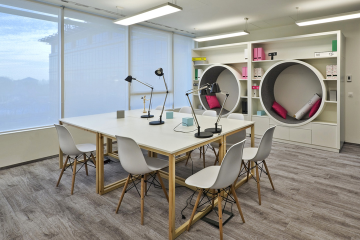ad retail store design has developed a new design program for tmobile located in warsaw poland a typical open office environment was redesigned to add l69 program