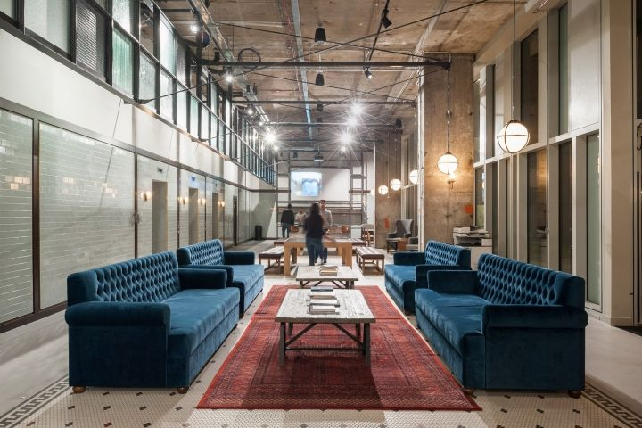 503f498767f Inside the building, the architects have returned the arrival hall to its  original concrete and steel construction, with booth-style seating areas  designed ...