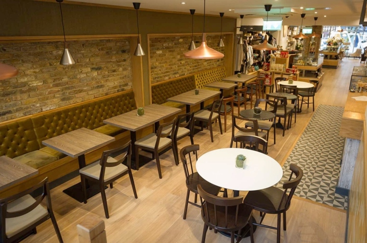 for the interior we aimed to create a warm welcoming space that would provide a simple showcase for the products on offer we used oak rich metallic tones - Slate Cafe Decoration