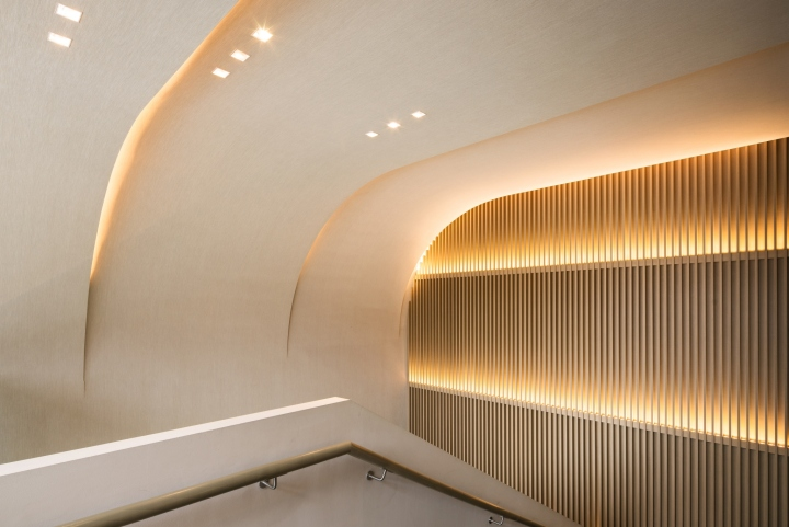 As guests climb the stair the ceiling folds over and the walls are lit by hidden uplights creating a warm and comforting environment