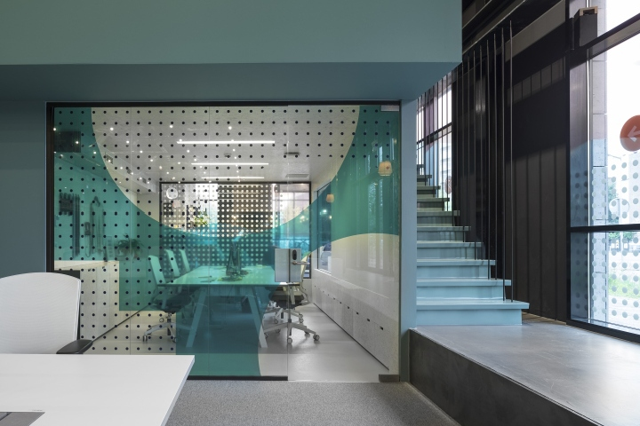 amsterdam studio ninetynine has transformed part of the ground floor of the former het parool office building with blue green painted pavilions