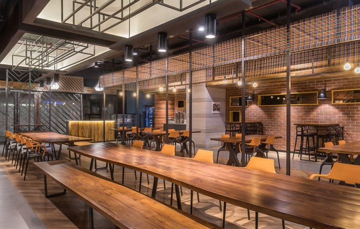 weve used lots of natural materials like raw wood stone concrete metal sap wanted the cafe to have an upscale feel hence the use of leather